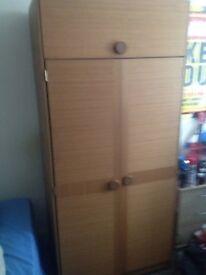 brown wardrobe with top storage draw.
