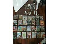 wii console with accessories and 28 games