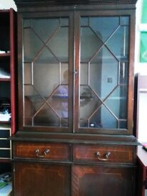 Wooden wall unit with drawers and cupboard available for sale.