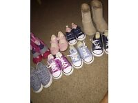A variety of toddler converse, ugg boots, vans and Clark shoes/trainers