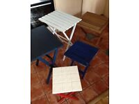 Several folding table different colours and sizes