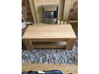 Coffee table with lift up storage