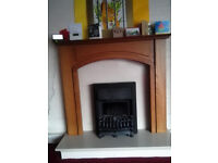 Fireplace with embedded electric fire