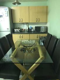 Glass table with light wood legs