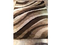 Lovely large brown patterned rug