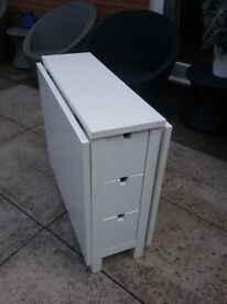 Fold away white table with 6 draws.
