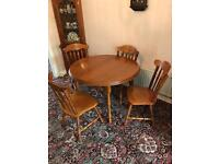 Solid oak wood round table complete with six chairs