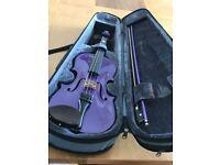 Child's half size purple coloured violin .