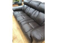 Brown leather three seater sofa mark on one of the seats but not bad