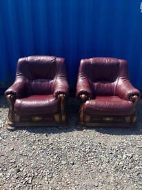 Pair Of oxblood red oak frame arm chairs
