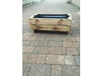 Planters and Benches made from recycled decking