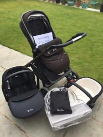 Silver cross Pioneer in black with graphite chassis. Inc car seat, seat unit and carry cot