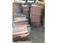 Approximately 700-800 roof tiles