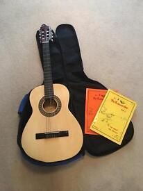 6 string wooden Guitar w/ bag & books