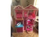 Barbie House for Sale inc dolls Furniture. Retails at £220.