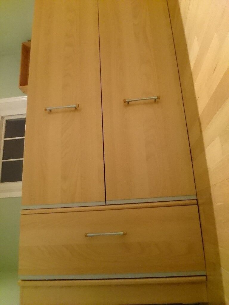 Wardrobe with mirror and drawer