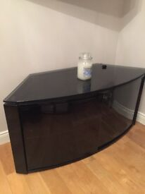 Curved black glass TV cabinet