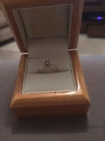 Diamond solitaire and white gold ring