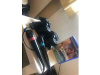 Playstation 2 with 2 consoles, 2 singstar microphone and 1 singstar game.