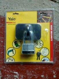 Yale wall/floor anchor and padlock.