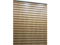 Slat wall oak shop fitting with black inserts