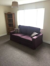 Pre-owned 3 seater deep purple material sofa. Very good condition from pet free and smoke free home
