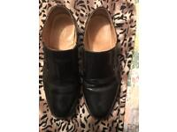 Black leather slip on shoes. Size 8
