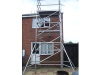 Young man boss tower scaffold