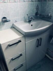 Bathroom sink fitted in cabinet