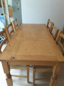6 Seater dinning table with chairs, solid wood well cared for from a pet and smoke free home