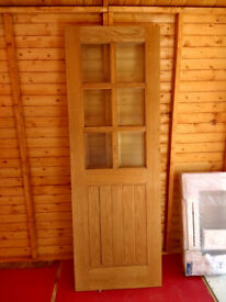 Jeld Wen half glazed hardwood door. 78 X 27