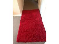 Luxury red shaggy rug
