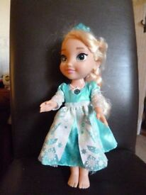 Frozen Toddler doll Elsa that talks, sings and lights up. - Shipley