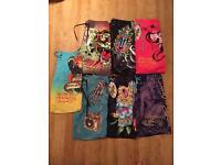 7 pairs of brand new authentic Ed Hardy and Christian Audigier men's swim shorts.