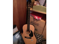 Acoustic Guitar, second hand, new strings, purchased from a shop at Glastonbury Festival £40