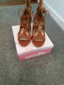 Brand new sandals. Size 5