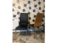 2 black leather chairs