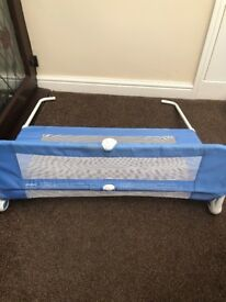 Children's blue safety bed guard