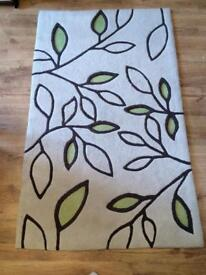 Soft and bouncy leaf pattern neutral rug