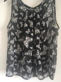 Sleeveless chiffon look blouse size 8