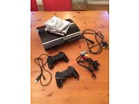 PlayStation 3 with controllers and 3 game bundle