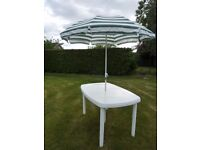 White Plastic Patio Table and Parasol