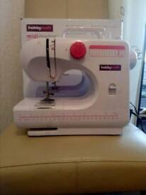 SMALL ELECTRIC SEWING MACHINE