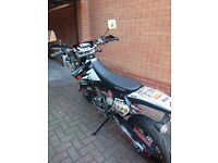 Suzuki DRZ400SM K7 Motorcycle in Black, low mileage, extras, custom graphics, excellent condition.