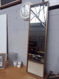 Gold framed wall mirror 34 cm wide x 125 cm high. Delivery can be arranged if required