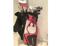 Ladies right hand golf clubs .