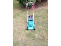 Bosh electric lawnmower with grass box 1000wt metal blade greed .