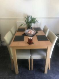 Dining room wooden table with 4 immaculate chairs
