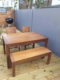 Dining table with bench and 2 chairs .