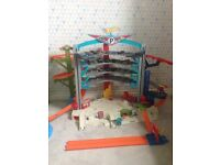 Hotwheels ultimate garage. With cars